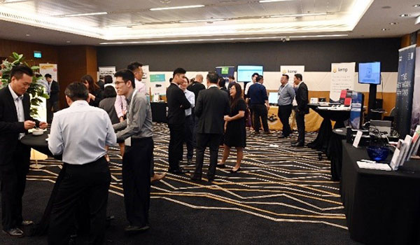 Delegates networking at the exhibition spaces